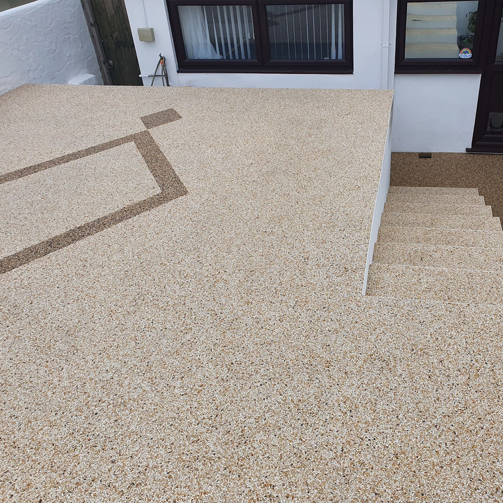 Raised resin parking area and steps with pattern