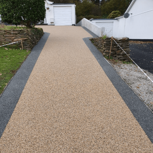 Long resin driveway and new wall