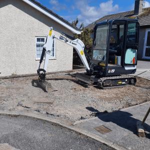 Mini digger preparing driveway